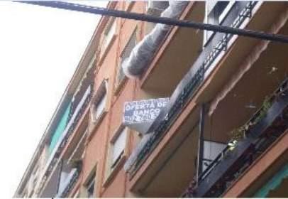 Pis a calle Sagrada Familia